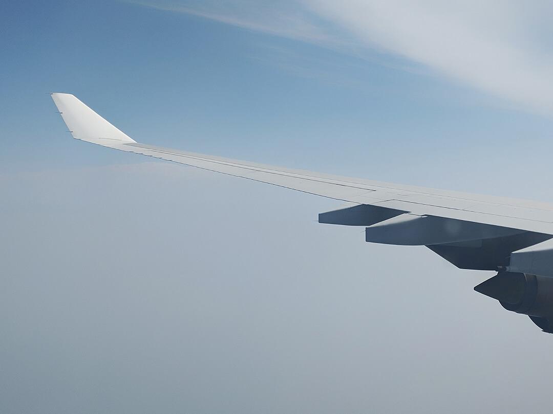 External view of plane wing in flight